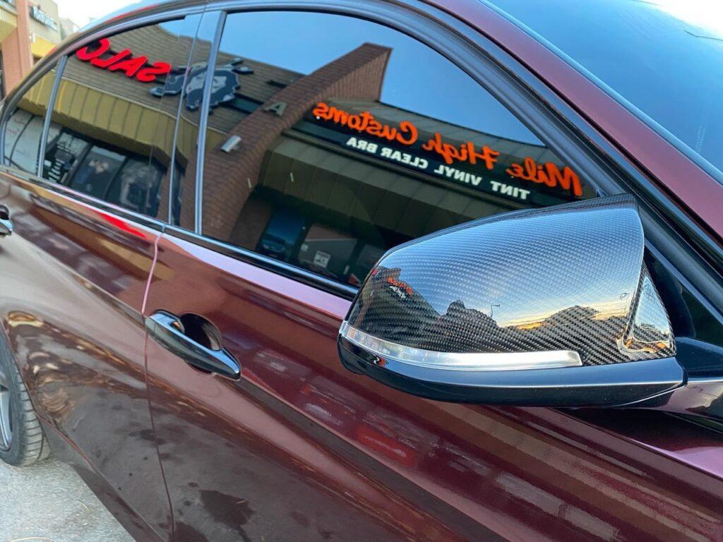 BMW 335i window tint side view, Mile High Customs logo reflection