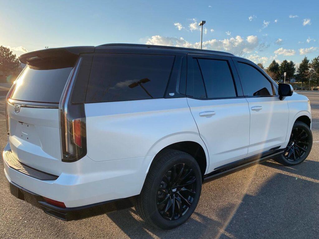 white 2021 Cadillac Escalade Llumar window tinting back side view