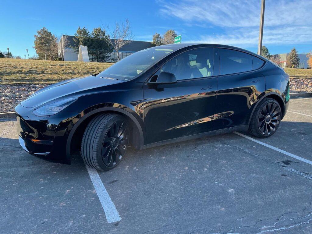 black Tesla Model Y 2 front windows tinted side view