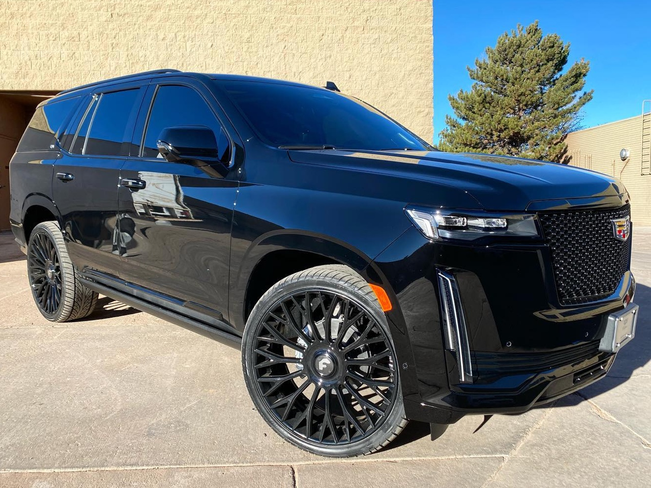 blacked out Cadillac Escalade front view