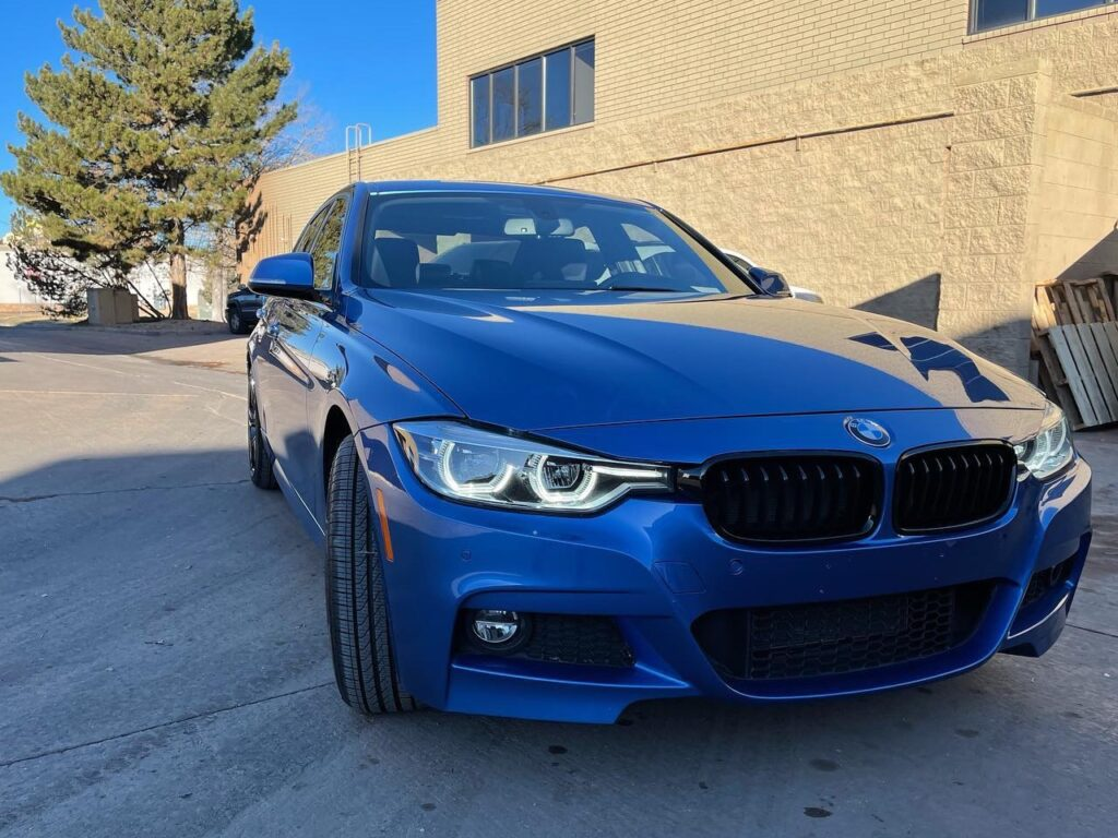 blue BMW 330 outside Mile High Customs